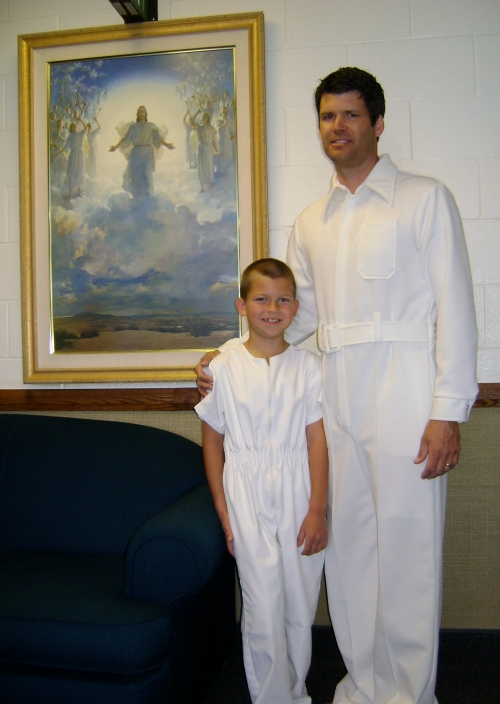 Jack and Dad dressed in white for the baptism.